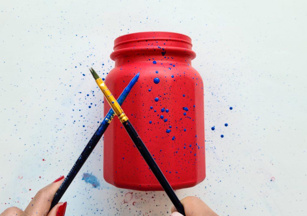 Splatter Blue Paint on Red Jar