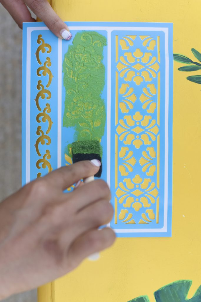 Paint using stencil on garden bench